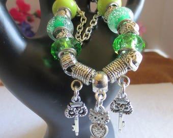 Large hole green beads with owls on snake bracelet