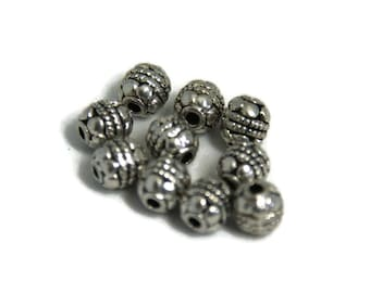 10 round massive silver metal beads 5, 5x6mm