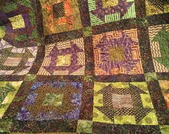Purple and green Churn Dash quilt