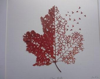 Handcraved maple leaf
