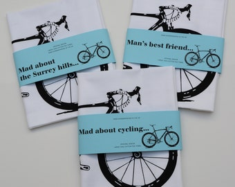 Hand screen printed tea towel with cycling design