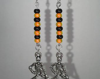 Silver Skeleton with orange and black beads dangle earrings