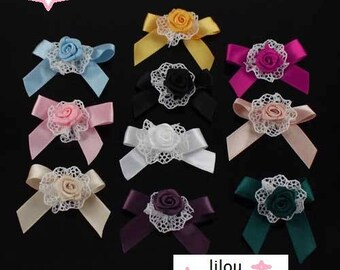 Multicolored ribbon bow has two flower Applique Satin bows