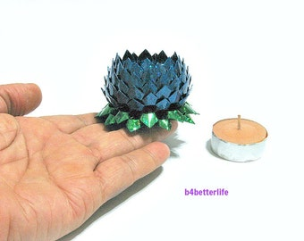 A piece of Small Size Blue Color Hand-folded Origami Lotus. (4D Glittering paper series).