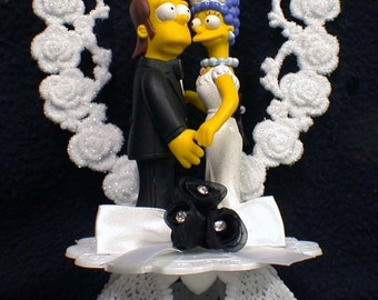 Young Homer & Marge Simpsons Wedding Cake Topper 139.00 OR add set for 89.00 more glasses. knife and book plus shipping