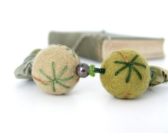 sterling silver necklace with green felt bead felt beads and silk yoyos