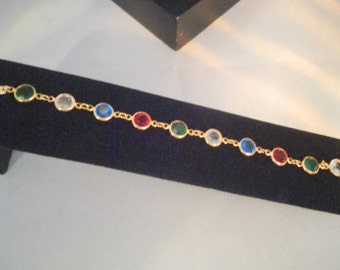 "Vintage 7.5""  SWAROVSKI Crystal Bracelet w/Red, Blue, Green and Clear Bezel Crystals. This Bracelet has an Authentic Swan Tag."