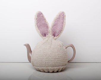 Knitted bunny rabbit tea cosy with pom pom bottom. Fits 6 cup 1 litre pot.