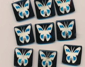 Nine pretty etched bone beads - butterflies with blue accents - 26.5 x 25 mm