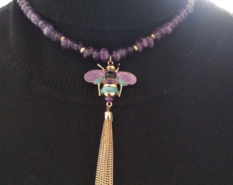 Amethyst necklace with a fly