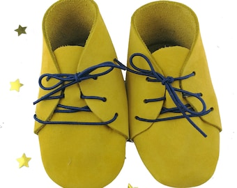 shoe for a newborn baby in purple and yellow velvet leather