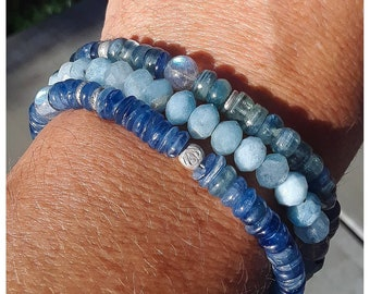 Triple strand Kayanite, Faceted Aquamarine, Labradorite, and Hill Tribe Fine Silver bracelet. Incredible!