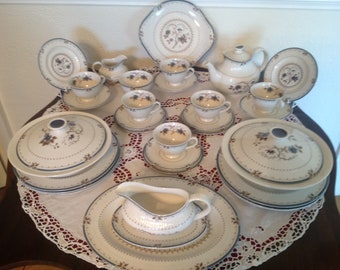 Royal Doulton tea set and part dinner set in the old