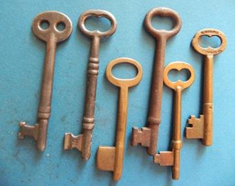 6 Antique Skeleton Keys. 3 Brass and 3 Steel.
