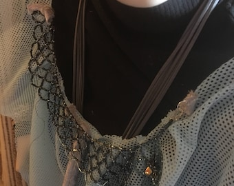 Poncho with detachable chain