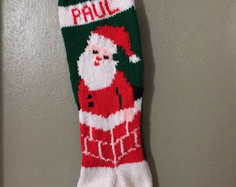 Personalized hand knitted stocking santa in a chimney