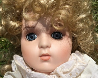 China Doll - china face, arms & feet - glass eyes - blonde ringlets - 44 cm tall - pretty pink dress - collectable - Good condition