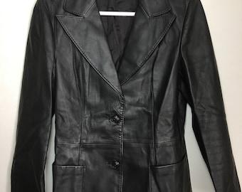 Black leather jacket woman size small - medium .