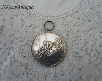 Cycling medal/pendant 1920's for the collector