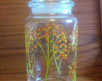 One Pyrex clear canister/glass jar with Orange, Yellow, Green Pyrex Daisey flower Tree design 1970's