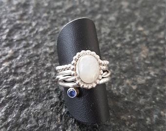 Silver ring with gemstone and Pearl edge