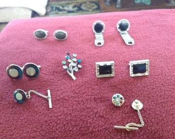 4sets of cufflinks and a lady's pin