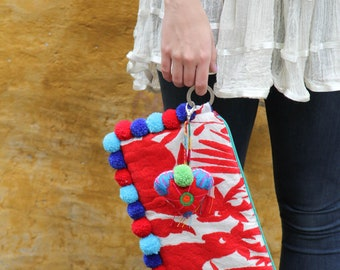Reds and blue pompoms and hand embroidered tassels