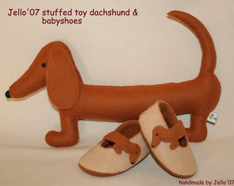 Babyshoes & toy dachshund