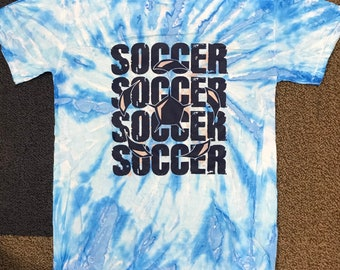 size small, short sleeved blue tie-dye soccer t-shirt.