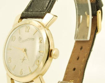 Lucien Piccard vintage wrist watch, 17 Jewels, gold-toned round smooth polish case, black leather strap band