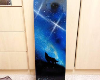 Spray painted skateboard deck - Howling wolf with galaxy back drop, personalised gift idea