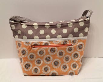 "LIP4- Lunch Bag: ""Dotty"" washable insulated lunch bag with zippered front pocket and zippered top closure."