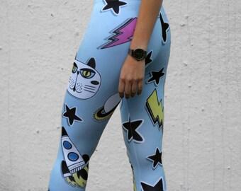 Cats stars spaceship lightning bolt on light blue leggings