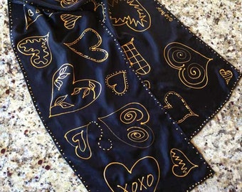 "Hand-Painted Silk Scarf 11""x60"": ""Hearts of Gold"" - Valentine Love GOLD Hearts in Assorted Designs on Black Silk with Pointelle Details"