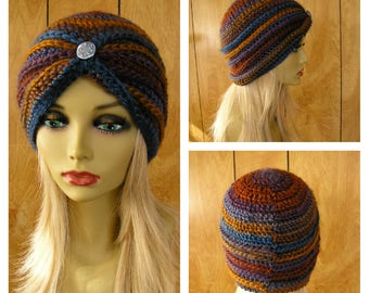 "Crochet turban hat, Mountain Range, blue, purple, brown and gold acrylic yarn with a metal button, will fit most, 21"" around"