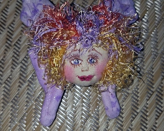 Whimsical, fiber sculpted butterfly fairy face pin, silk face