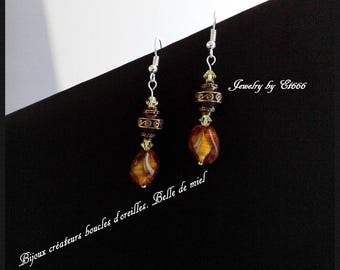 Jewelry designers earrings. Beautiful honey