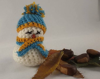 Christmas crochet amigurumi, snowman with yellow and light blue scarf and hat