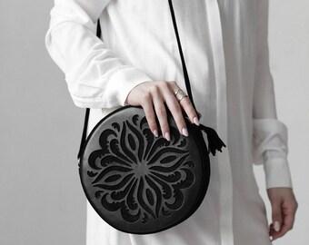 round bag. circle bag. black crossbody bag. black crossbody. circle shoulder bag. round shoulder bag. leather round bag. black circle bag