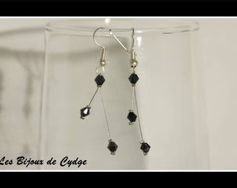 Earrings on twisted wire and its black bicone bead