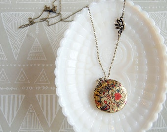 vintage style floral and bird patterned locket - leaf detail- long chain