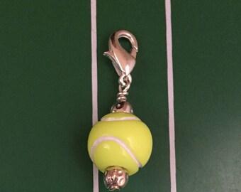 Tennis ball good luck charm, zipper pull