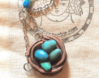 Nest with blue eggs one of a kind polymer clay pendant necklace original art by Cortney Rector Designs