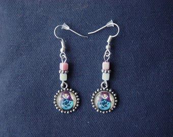 Background blue matryoshka earrings beige