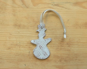 Ceramic snowman ornament - with lace pattern.