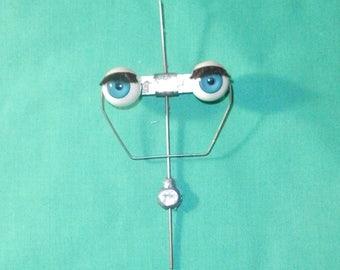 "vintage blue sleepy eyes/plastic 2.38""/0.73""/Germany"