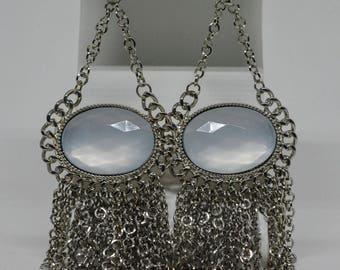 Lovely neutral color silver tone earrings