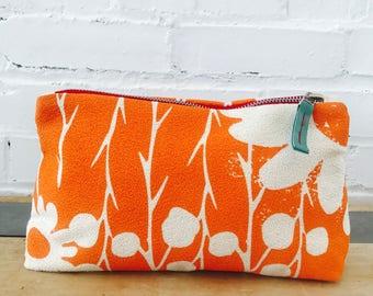 Orange Daisy Thorn makeup zipper bag