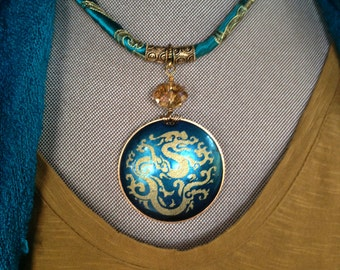 Golden Dragon, silk screened polymer clay pendant