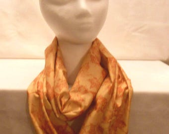 Light orange infinity scarf with burnt orange leaves